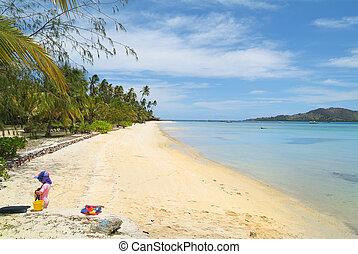 Fiji - Malolo Lailai Island, Fiji - child playing on beach...