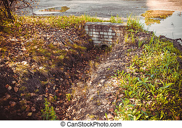 Old Rural Ditch - Old ditch through with water in the...
