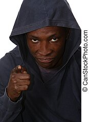 Angry Young Mobster - Angry young black man with hood over...