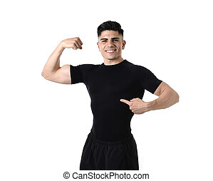attractive sport man pointing on his black t-shirt with copy...