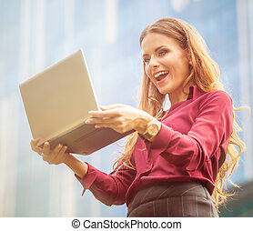 Businesswoman using Skype - Businesswoman smiling for the...