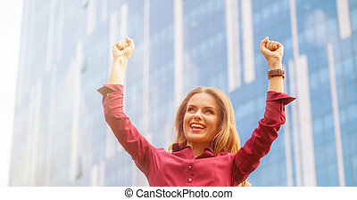 Businesswoman celebrating victory - Close-up portrait of...