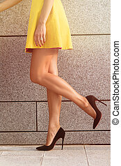 Womans legs in full length - Close-up image of womans legs...