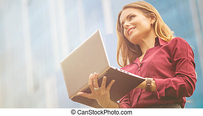Businesswoman in the city - Businesswoman working with...