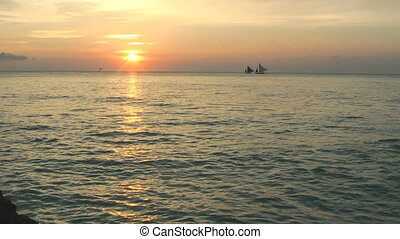 Sailboat during sunset time - Sunset on Boracay island,...