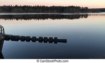 Beautiful landscape with reflection of trees in water. Video...