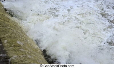 Camera shoots the river then slowly rises up and removes a...