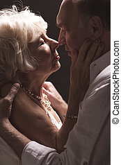 Feeling safe in each other's arms - Shot of an elderly...