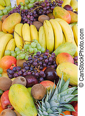 Mixed fruit vertical - Mound of mixed fruit including green...