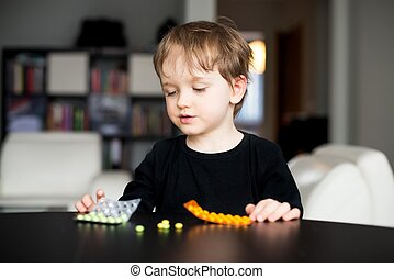 Little boy playing with medicines - Little boy playing with...