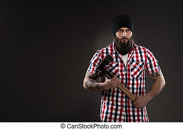 Bearded man like woodcutter holding an old axe
