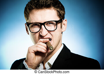 Man smoking cigar - Man in glasses smoking cigar