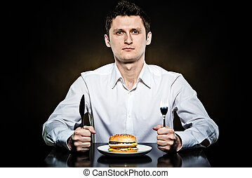 Hungry man is going to eat a burger - Hungry man in the...