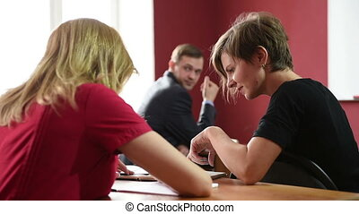 Serious students sitting for an examination in class