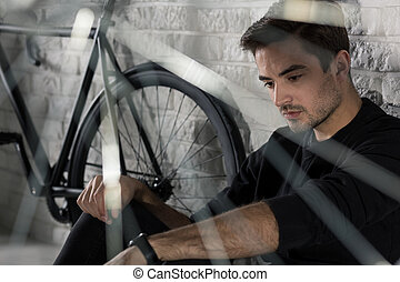 Go on bicycle and forget about problems - Sad man sitting on...