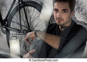 Keep calm and bike on! - Handsome, young man sitting on...