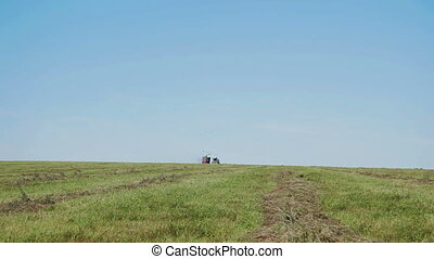 Farmer harvesting silage Combain in field - farmer combain...
