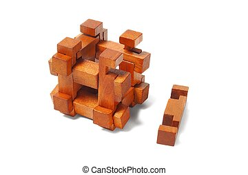 Wooden puzzle - Classic wooden puzzle isolated on white...