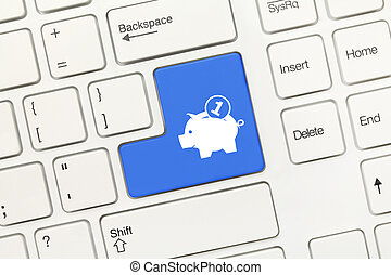 White conceptual keyboard - Blue key with moneybox symbol -...