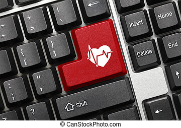 Conceptual keyboard - Red key with cardiology symbol -...