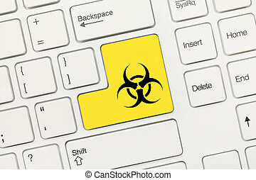 White conceptual keyboard - Yellow key with biohazard symbol