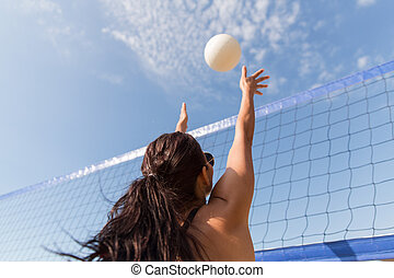 young woman with ball playing volleyball on beach - summer...