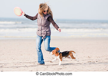 Girl playing with dog - Girl playing with her beagle puppy...