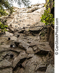Rung steps on via ferrata - Rung steps and steel cable on...