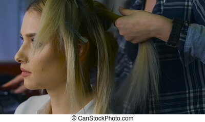 in a beauty salon eccentric stylist makes professional...