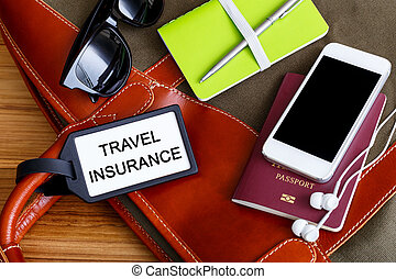 Travel insurance tag with tourist accessories