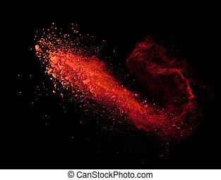 Explosion of red powder on black background - Explosion of...