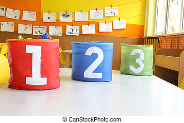 Red Green and blue jars with written one two and three on...