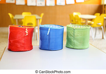 three colored fabric containers for childrens toys in the...