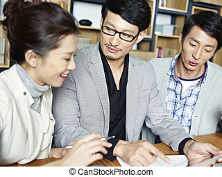 young asian business people working together in office -...