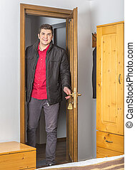 Tourist Entering in the Hostel Room - Young happy tourist...