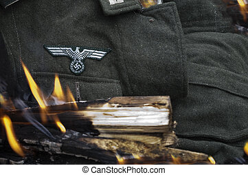 Uniform In Flame - Focus on a nazi uniform, burning flame in...