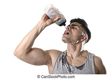 young athletic sport man thirsty drinking water holding...