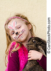 kid with face painting and rabbit animal