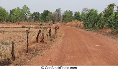 Gravel Road unpaved road in rural area at Thailand