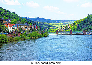 Quay of Neckar river and bridge in Heidelberg in Germany -...