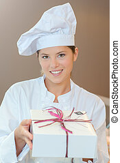 Patisserie chef holding a gift box
