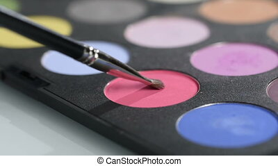 lipstick with a brush make-up on black lipstick palette