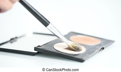brush and powder. palette - brush and powder on a white...
