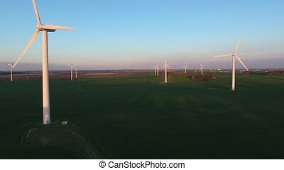 Wind turbine against deep blue sky evening
