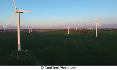 Wind turbine against deep blue sky