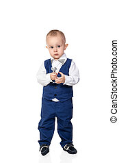 Kid in business suit with a wrench