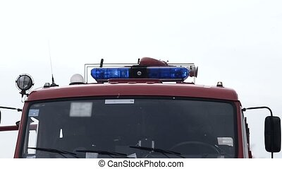 Blue lights on the fire truck siren - Close-up picture of...