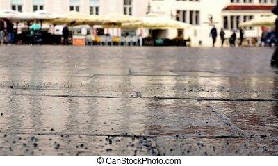 Market square rain pattering - Rain pattering on market...