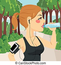 Woman Runner Drinking Water - Beautiful young runner woman...