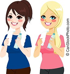 Women With Water Bottle - Beautiful fit young women in...